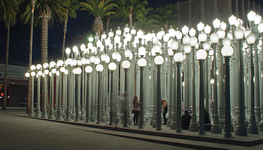 Urban Light 2008 by Chris Burden, hundreds of vintage streetlights are arranged in tight symmetrical rows.