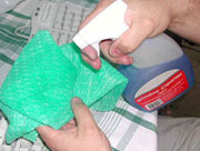 Spray a few drops of Windex on a soft cloth
