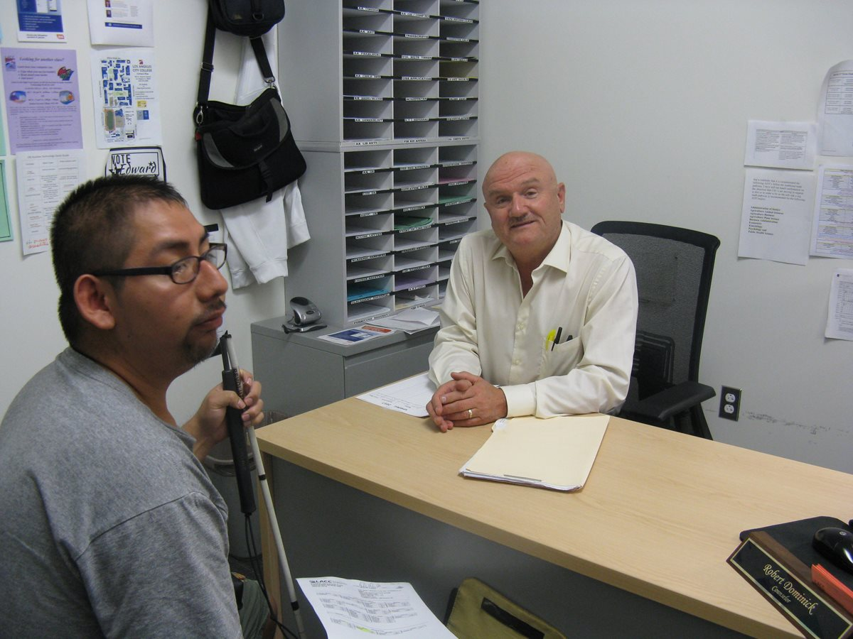 OSS Counselor Robert Dominick meeting with LACC student Giovanni Morales