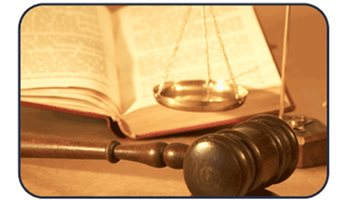 Gavel, law book, and scales of justice